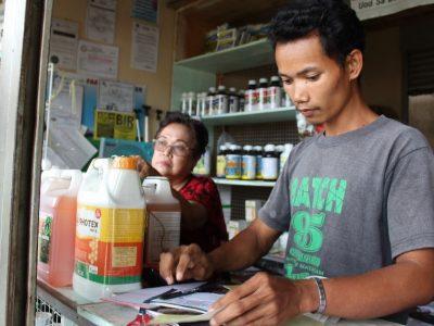 Farmer Albert Pendijo also sidelines as sales clerk for the Taculen Farmers' MPC