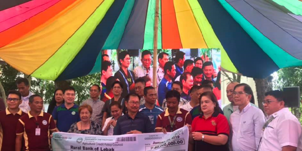DA Secretary Piñol and ACPC Executive Director Jocelyn Badiola leading the turnover of P40 million to the Rural Bank of Lebak for the launch of the PLEA-NFA scheme.